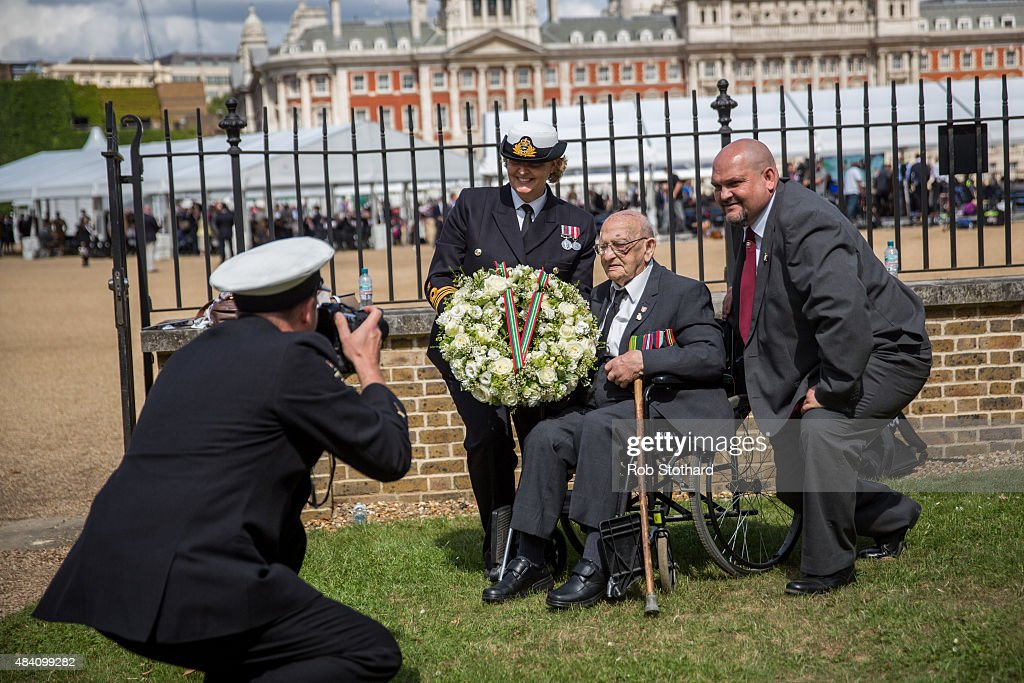A Ministry of Defence photographer takes a photograph of Gordon Smith, a veteran of the Royal Army Ordnance Corps, ahead of a wreath laying ceremony during the 70th Anniversary commemorations of VJ Day (Victory over Japan) at Horse Guards Parade on August 15, 2015 in London, England. The event marks the 70th anniversary of the surrender of Japanese Forces, bringing about the end of World War II. Queen Elizabeth II and Prince Philip, Duke of Edinburgh will join British Prime Minister David Cameron and former prisoners of war during services throughout the day as tributes are made to the the estimated 71,244 British and Commonwealth casualties of the Far East conflict. Japan formally surrendered on September 2, 1945 at a ceremony in Tokyo Bay on USS Missouri.