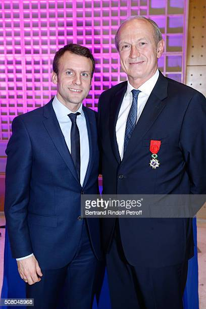 Ministry of Economy, Industry and Digital Emmanuel Macron gives to President of l'Oreal Jean-Paul Agon Insignia of Officer of the Legion of Honor at...