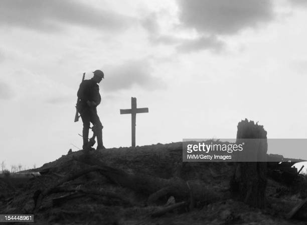 Ministry Of Information First World War Official Collection A British soldier stands besides the grave of a comrade near Pilckem during the Third...