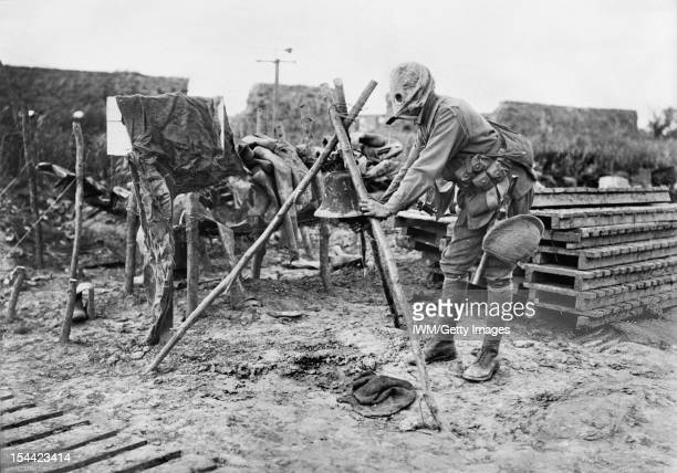 Ministry Of Information First World War Official Collection A gas sentry ringing an alarm at Fleurbaix 15 miles south of Ypres June 1916