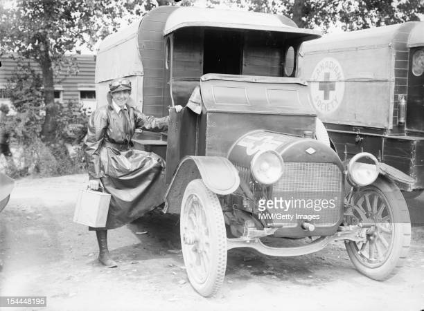 Ministry Of Information First World War Official Collection A member of the Voluntary Aid Detachment with her motor ambulance a vehicle of the...
