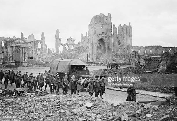Ministry Of Information First World War Official Collection Battle of Menin Road Ridge German prisoners being marched through the Cathedral Square...