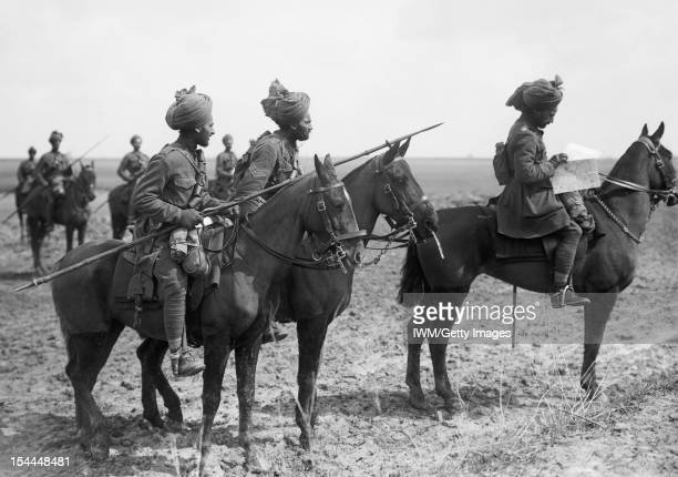 Ministry Of Information First World War Official Collection Forward scouts of the 9th Hodson's Horse an Indian cavalry regiment pause to consult a...