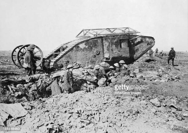 Ministry Of Information First World War Official Collection, Mark I 'Male' Tank of 'C' Company that broke down crossing a British trench on its way...