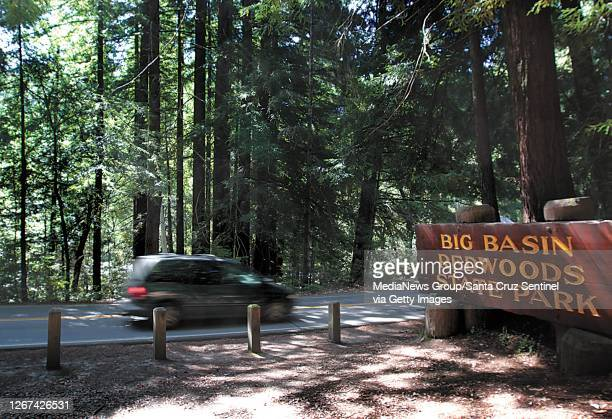 Minivan drives through the southern entrance of Big Basin Redwoods State Park along California State Route 236 on July 25, 2012.