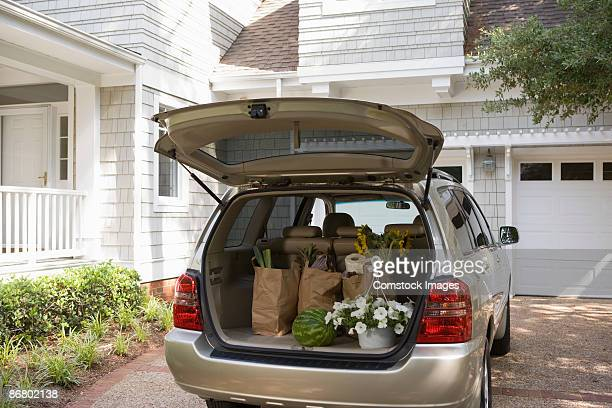 mini-van with groceries and flowers - car trunk stock pictures, royalty-free photos & images