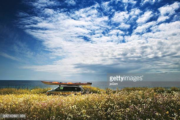 mini-van with kayak on roof and bicycle rack on back, side view - western usa stock pictures, royalty-free photos & images