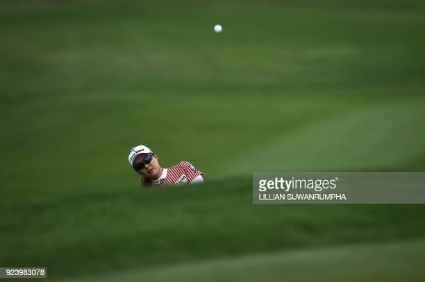 TOPSHOT Minjee Lee of Australia hits a shot during the final round of the Honda LPGA golf tournament at the Siam Country Club in the coastal Thai...