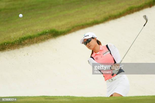 Minjee Lee of Australia plays a shot from a bunker on the 18th hole during round one of the HSBC Women's World Championship at Sentosa Golf Club on...