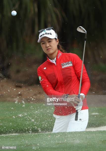 Minjee Lee of Australia plays a shot from a greenside bunker on the sixth hole during round one of the CME Group Tour Championship at the Tiburon...