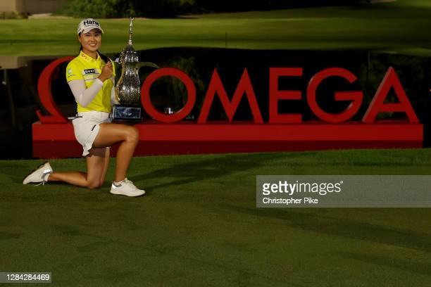 Minjee Lee of Australia poses with the trophy after winning the Omega Dubai Moonlight Classic at Emirates Golf Club on November 06, 2020 in Dubai,...