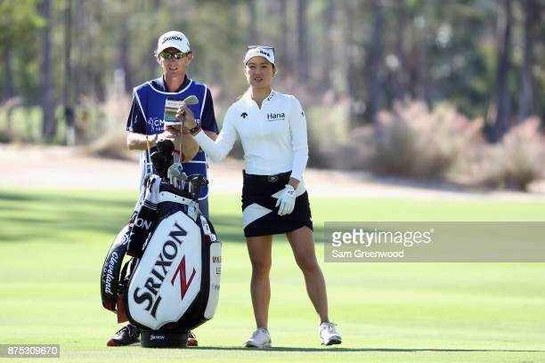 Minjee Lee of Australia pulls a club from her bag as she prepares to play a shot on the second hole during round two of the CME Group Tour...