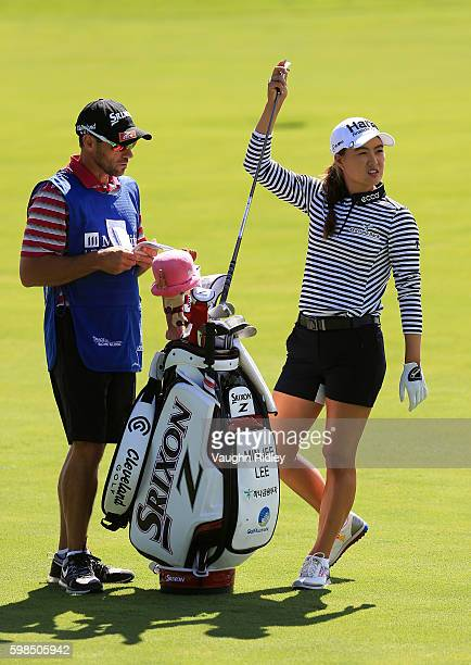 Minjee Lee of Australia pulls a club from her bag prior to taking her second shot on the 12th hole during the first round of the Manulife LPGA...