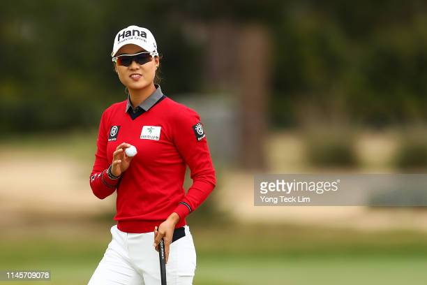 Minjee Lee of Australia reacts to the crowd after sinking a putt on the first hole during the final round of the HUGELAIR PREMIA LA Open at Wilshire...