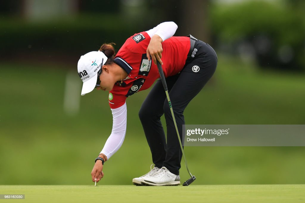 Minjee Lee of Australia repairs a ball mark during the final round of the Walmart NW Arkansas Championship Presented by P&G at Pinnacle Country Club on June 24, 2018 in Rogers, Arkansas.