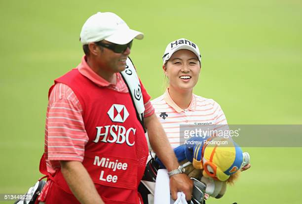 Minjee Lee of Australia smiles with her caddie on the 18th hole during the first round of the HSBC Women's Champions at Sentosa Golf Club on March 3...