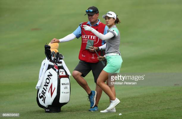 Minjee Lee of Australia takes a club from her bag on the on the third hole during the third round of the LPGA LOTTE Championship Presented By Hershey...