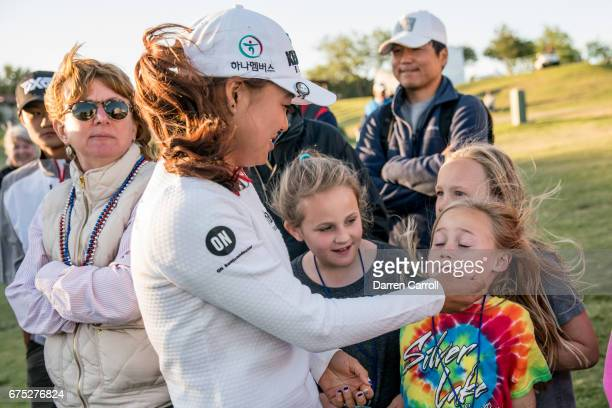 Minjee Lee of Australia talks with young fans at the 18th green during the final round of the Volunteers of America North Texas Shootout at Las...