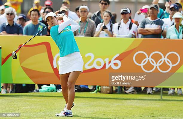 Minjee Lee of Australia watches her tee shot on the first hole during the third round of the Women's Individual Stroke Play golf on Day 14 of the Rio...