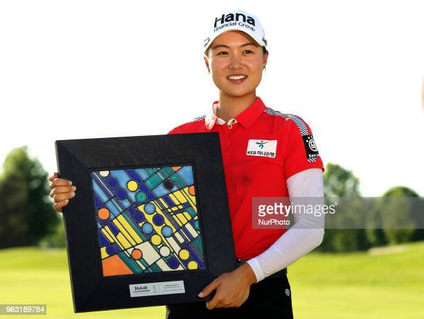 Minjee Lee of Perth Australia holds the trophy after winning the tournament during the final round of the LPGA Volvik Championship at Travis Pointe...