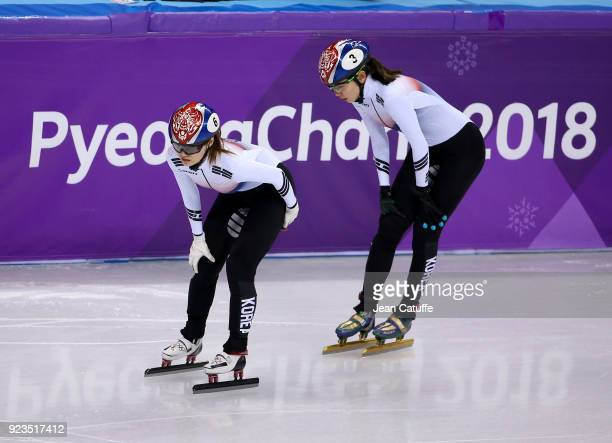 Minjeong Choi and Sukhee Shim of South Korea look dejected after crashing during the Short Track Speed Skating Women's 1000m Final A on day thirteen...