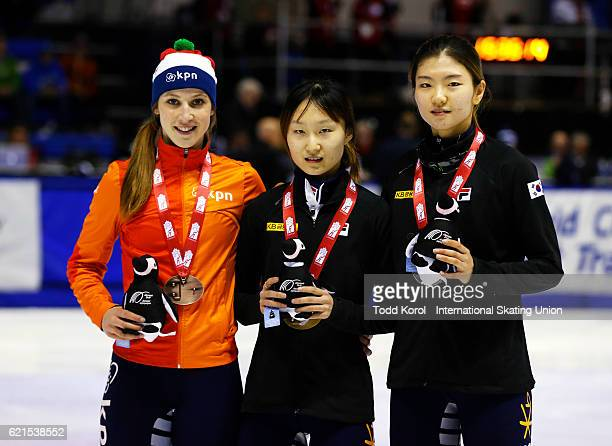Minjeong Choi of Korea celebrates her gold medal with teammate Suk Hee Shim who won silver and Suzanne Schulting of the Netherlands who won bronze in...