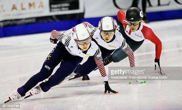 Minjeong Choi of Korea leads teammate Suk Hee Shim and Valerie Maltais of Canada in the women's 1000 meter semi final during the ISU World Cup Short...