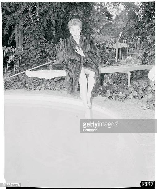 A mink coat over her swimsuit Debra poses for a Hollywood type glamour shot at her pool After all what's a movie star without a swimming pool eh
