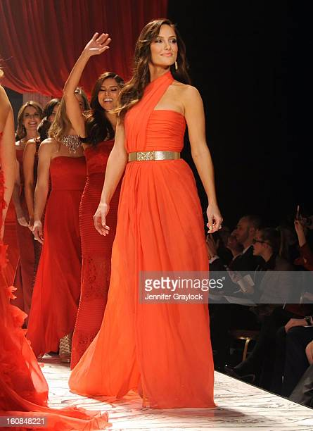 Minka Kelly and Roselyn Sanchez on the runway during The Heart Truth 2013 Fashion Show held at the Hammerstein Ballroom on February 6 2013 in New...