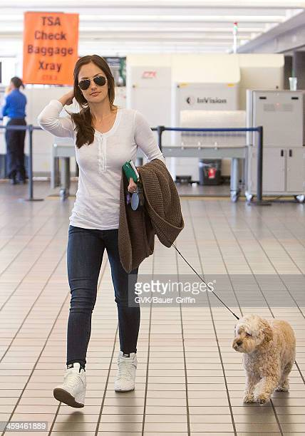 Minka Kelly is seen at Los Angeles International Airport with her puppy Chewy on March 10 2013 in Los Angeles California