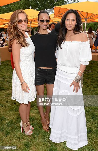 Minka Kelly, Zoe Saldana and Padma Lakshmi pose at the VIP Marquee during the fifth Annual Veuve Clicquot Polo Classic on June 2, 2012 in Jersey City.