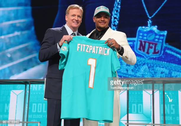 Minkah Fitzpatrick of Alabama poses with NFL Commissioner Roger Goodell after being picked overall by the Miami Dolphins during the first round of...