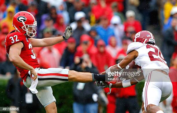 Minkah Fitzpatrick of the Alabama Crimson Tide blocks a punt by Collin Barber of the Georgia Bulldogs and recovers it for a touchdown at Sanford...