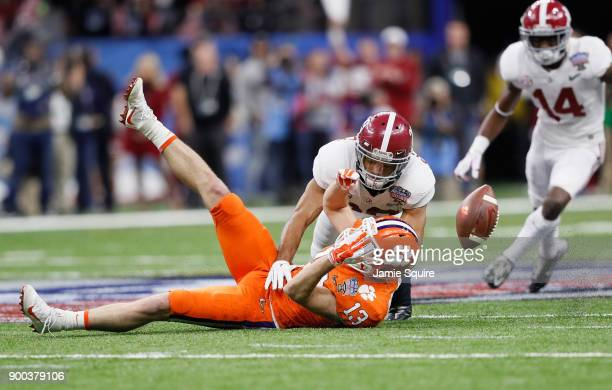 Minkah Fitzpatrick of the Alabama Crimson Tide breaks up a pass intended for Hunter Renfrow of the Clemson Tigers in the first half of the AllState...