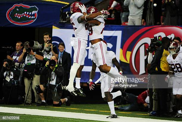 Minkah Fitzpatrick of the Alabama Crimson Tide celebrates with Marlon Humphrey after returning an interception for a touchdown against the Florida...