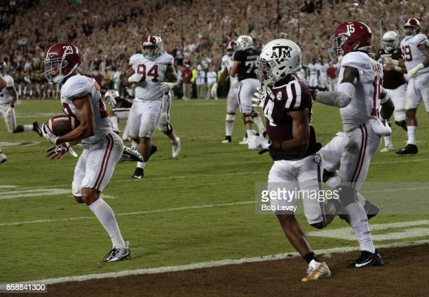 Minkah Fitzpatrick of the Alabama Crimson Tide intercepts a pass intended for Damion Ratley of the Texas AM Aggies at Kyle Field on October 7 2017 in...