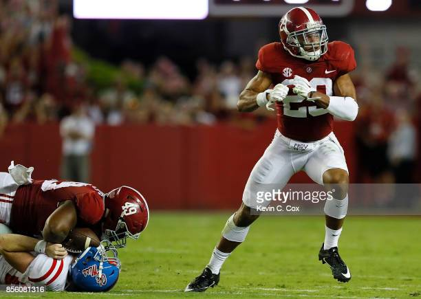 Minkah Fitzpatrick of the Alabama Crimson Tide reacts after he and Isaiah Buggs sack Shea Patterson of the Mississippi Rebels at BryantDenny Stadium...