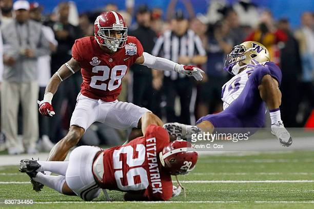 Minkah Fitzpatrick of the Alabama Crimson Tide tackles Andre Baccellia of the Washington Huskies during the 2016 ChickfilA Peach Bowl at the Georgia...