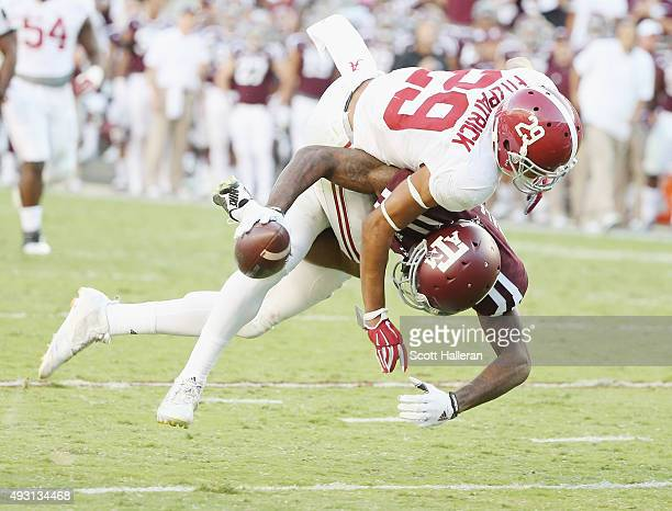 Minkah Fitzpatrick of the Alabama Crimson Tide tackles Ricky SealsJones of the Texas AM Aggies in the second half of their game at Kyle Field on...