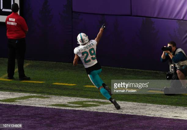 Minkah Fitzpatrick of the Miami Dolphins celebrates scoring a touchdown after intercepting a pass by Kirk Cousins of the Minnesota Vikings in the...
