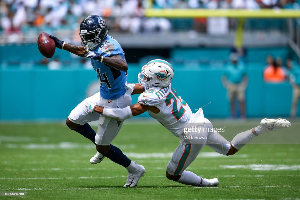 Minkah Fitzpatrick #29 of the Miami Dolphins makes the tackle on Corey Davis #84 of the Tennessee Titans during the first quarter at Hard Rock Stadium on September 9, 2018 in Miami, Florida.