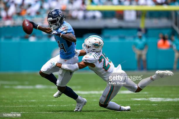 Minkah Fitzpatrick of the Miami Dolphins makes the tackle on Corey Davis of the Tennessee Titans during the first quarter at Hard Rock Stadium on...