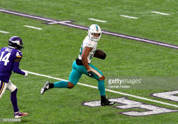 Minkah Fitzpatrick of the Miami Dolphins runs with the ball after intercepting a pass by Kirk Cousins of the Minnesota Vikings in the second quarter...