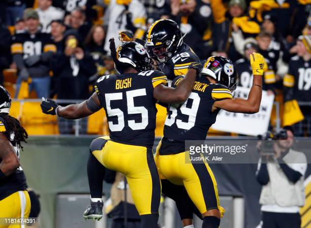 Minkah Fitzpatrick of the Pittsburgh Steelers celebrates with Devin Bush and Kam Kelly after recovering a fumble for a 43 yard touchdown in the first...