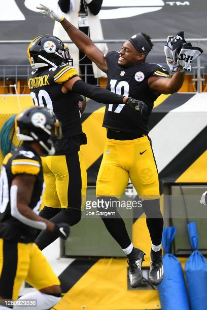 Minkah Fitzpatrick of the Pittsburgh Steelers celebrates with JuJu Smith-Schuster after his interception for a touchdown of Baker Mayfield of the...