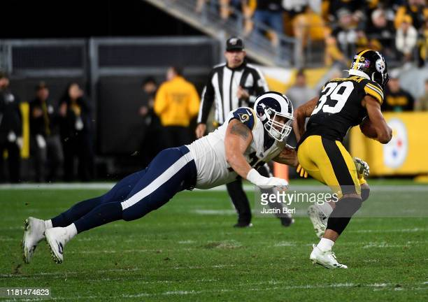Minkah Fitzpatrick of the Pittsburgh Steelers returns a fumble as Rob Havenstein of the Los Angeles Rams attempts a tackle in the second quarter at...