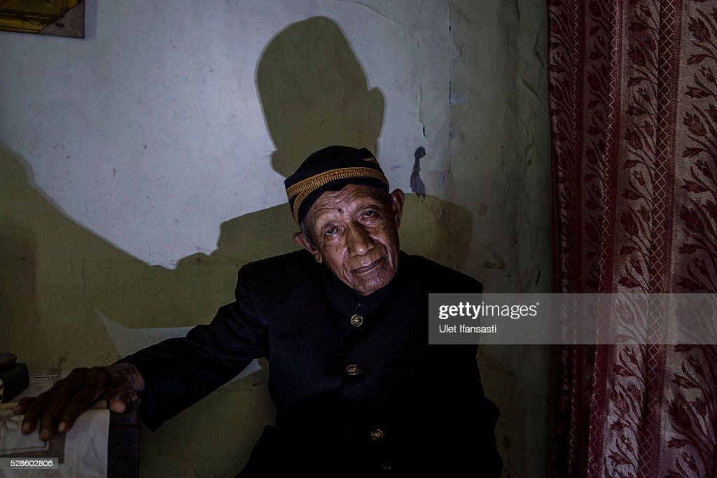 Minkarto, 75 years old, sits at his house on May 05, 2016 in Kendal, Central Java. Minkarto, was a teacher, who spent 8 years imprisoned without trial for suspected ties to the Indonesian Communist Party (PKI). Survivors of Indonesia's anti-communist massacres in 1965 called for investigations on the country's purges, in which hundreds of thousands of people are believed to have been killed by the Indonesian military when the Cold War was escalating in Southeast Asia. Based on human rights groups, half a million people died in 1965 during a massacre carried out by the military and religious groups after an attempted coup by suspected communists, where an officer-led group kidnapped and executed six generals on the night of Septemeber 30, 1965. Known as one of the worst mass atrocities of the 20th century, many among the dead had no connection to Communism, and hundreds of thousands had been held in dentention centers for years during the period.