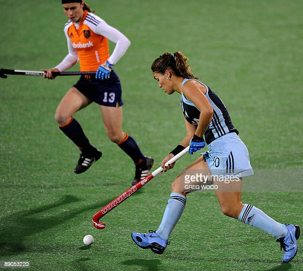 Minke Smeets of the Netherlands runs in to stop Soledad Garcia of Argentina during their Women's Champions Trophy hockey match in Sydney on July 16...