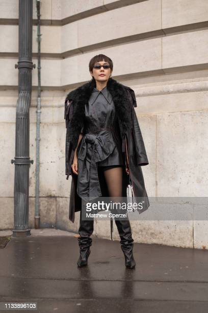 Minkie Saowakon Yamcharoen is seen on the street attending ANAIS JOURDEN during Paris Fashion Week AW19 wearing black leather dress and black fur...
