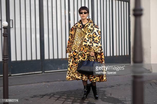Minkie Saowakon Yamcharoen is seen on the street during Paris Fashion Week AW19 wearing a Richard Quinn dress Prada sunglasses Alexandre Vauthier...